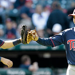 Minnesota Twins relief pitcher Brian Fuentes (51) and catcher Joe Mauer celebrate after they defeated the Cleveland Indians 6-2 in a baseball game, Sunday, Sept. 12, 2010, in Cleveland. (AP  ...