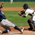 Minnesota Twins' Jim Thome, left, beats the throw to home as Cleveland Indians catcher Chris Gimenez waits for the ball in the first inning of a baseball game, Sunday, Sept. 12, 2010, in Cle ...