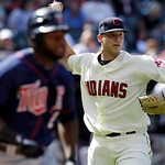 Cleveland Indians pitcher Justin Masterson, right, throws out Minnesota Twins' Denard Span in the seventh inning in a baseball game, Sunday, Sept. 12, 2010, in Cleveland. (AP Photo/Tony Deja ...