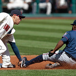 Minnesota Twins' Denard Span, right, safely steals to second base as Cleveland Indians shortstop Asdrubal Cabrera cannot hold onto the ball in the first inning in a baseball game, Sunday, Se ...