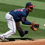Minnesota Twins shortstop Alexi Casilla fields a ball hit by Cleveland Indians' Jayson Nix in the inning in a baseball game, Sunday, Sept. 12, 2010, in Cleveland. Nix was safe at first base  ...