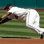 Cleveland Indians second baseman Luis Valbuena dives for a single hit by Minnesota Twins' Orlando Hudson in the first inning in a baseball game, Sunday, Sept. 12, 2010, in Cleveland. (AP Pho ...