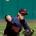 Minnesota Twins starting pitcher Kevin Slowey delivers in the first inning in a baseball game against the Cleveland Indians, Sunday, Sept. 12, 2010, in Cleveland. (AP Photo/Tony Dejak)