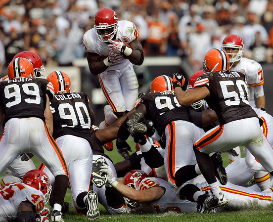 bb5d2b21c0f Kansas City Chiefs running back Thomas Jones leaps over the Cleveland Browns  defensive line on fourth down late in the fourth quarter of an NFL football  ...