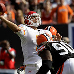 Kansas City Chiefs quarterback Matt Cassel gets hit by Cleveland Browns defensive end Kenyon Coleman (90) and a teammate as he releases a pass in the fourth quarter of an NFL football game S ...