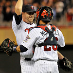 Minnesota Twins relief pitcher Matt Capps celebrates with catcher Jose Morales after the ninth inning of a baseball game against the Cleveland Indians Tuesday, Sept. 21, 2010, in Minneapolis ...