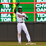 Minnesota Twins' Orlando Hudson reacts after hitting a run-scoring double during the eighth inning of a baseball game against the Cleveland Indians Tuesday, Sept. 21, 2010, in Minneapolis. T ...