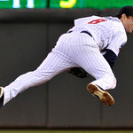 Minnesota Twins' Nick Punto makes a late throw on a ball hit by Cleveland Indians' Drew Sutton during the seventh inning of a baseball game Tuesday, Sept. 21, 2010, in Minneapolis. (AP Photo ...