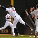 Minnesota Twins first baseman Michael Cuddyer (5) reaches for a throw as Cleveland Indians' Jordan Brown (35) makes it to first on an infield single during the sixth inning of a baseball gam ...