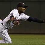 Minnesota Twins second baseman Orlando Hudson makes a diving catch on a ball hit by Cleveland Indians' Andy Marte during the second inning of a baseball game Tuesday, Sept. 21, 2010, in Minn ...