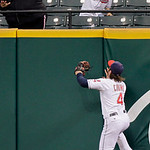Cleveland Indians right fielder Trevor Crowe (4) leaps at the wall but cannot catch a two-run home run by Detroit Tigers' Ryan Raburn in the first inning of the second game of a baseball dou ...