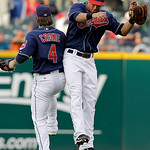 Cleveland Indians left fielder Trevor Crowe (4) and center fielder Michael Brantley celebrate after the Indians' 4-0 win over the Detroit Tigers in the first game of a baseball doubleheader  ...
