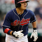 Cleveland Indians' Shin-Soo Choo, from South Korea, watches his two-run home run in the fifth inning of the first baseball game of a doubleheader against the Detroit Tigers on Wednesday, Sep ...