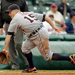 Detroit Tigers third baseman Brandon Inge can't handle a ground ball by Cleveland Indians' Matt LaPorta that went for a double during the fifth inning in the first game of a baseball doubleh ...
