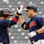 Cleveland Indians' Travis Hafner, right, is greeted by Shin-Soo Choo after Hafner's two-run home run in the third inning of the first game of a baseball doubleheader against the Detroit Tige ...