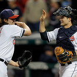 Cleveland Indians relief pitcher Chris Perez, left, celebrates with catcher Lou Marson after the final out in the Indians' 4-3 win over the Detroit Tigers in the second game of a baseball do ...