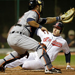 Cleveland Indians' Lou Marson, right, slides home to score past Detroit Tigers catcher Gerald Laird in the fifth inning of the second game of a baseball doubleheader Wednesday, Sept. 29, 201 ...