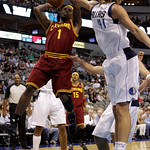 Cleveland Cavaliers point guard Daniel Gibson (1) attempts a shot as Dallas Mavericks' Dirk Nowitzki (41) of Germany defends in the first half of a preseason NBA basketball game, Monday, Oct ...