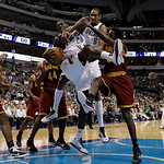 Cleveland Cavaliers forward Samardo Samuels (24) and Dallas Mavericks guard Dominique Jones, right, look on as Mavericks center Ian Mahinmi (28) of France, Alexis Ajinca (8) of France and  C ...