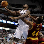 Dallas Mavericks guard Dominique Jones, left, attempts a shot over Cleveland Cavaliers forward Leon Powe (44) in the second half of a preseason NBA basketball game Monday, Oct. 11, 2010, in  ...