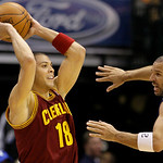 Cleveland Cavaliers' Anthony Parker (18) attempts to pass the ball as Dallas Mavericks' Jason Kidd defends in the second half of a preseason NBA basketball game, Monday, Oct. 11, 2010, in Da ...