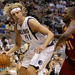 Dallas Mavericks power forward Dirk Nowitzki (41) of Germany looks for an opening against Cleveland Cavaliers forward Jawad Williams (31) in the second half of a preseason NBA basketball gam ...