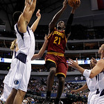 Cleveland Cavaliers forward J.J. Hickson (21) attempts a shot between the defense of Dallas Mavericks' Tyson Chandler, left, and Jason Kidd, right, in the first half of a preaseason NBA bask ...