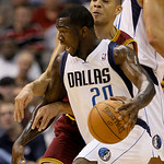 Dallas Mavericks' Dominique Jones (20) drives around Cleveland Cavaliers' Anthony Parker, rear, in the first half of a preseason NBA basketball game, Monday, Oct. 11, 2010, in Dallas. (AP Ph ...