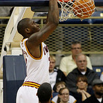 Cleveland Cavaliers' Samardo Samuels, top, dunks over San Antonio Spurs' George Hill in the first half of the NBA preseason basketball game on the University of Pittsburgh campus, Thursday,  ...