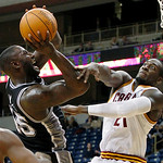 San Antonio Spurs' DeJuan Blair, left, shoots over Cleveland Cavaliers defender J.J. Hickson in the first half of the NBA preseason basketball game on the University of Pittsburgh campus, Th ...