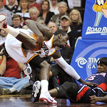 Cleveland Cavaliers' J.J. Hickson, left, is called for traveling while colliding with Atlanta Hawks' Josh Smith during the third quarter of an NBA basketball game in Cleveland, Tuesday, Nov. ...