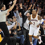 Fans cheer after Cleveland Cavaliers guard Mo Williams made a 3-point basket against the Atlanta Hawks in the third quarter of an NBA basketball game in Cleveland, Tuesday, Nov. 2, 2010. The ...