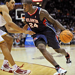 Atlanta Hawks' Marvin Williams drives to the basket past Cleveland Cavaliers' Ryan Hollins during the fourth quarter of an NBA basketball game in Cleveland, Tuesday, Nov. 2, 2010. The Hawks  ...