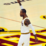 Cleveland Cavaliers guard Mo Williams acknowledges the cheers as he enters the NBA basketball game against the Atlanta Hawks, making his season debut, in Cleveland on Tuesday, Nov. 2, 2010.  ...