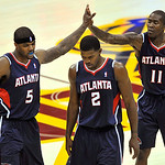 Atlanta Hawks' Josh Smith, left, Joe Johnson, center, and Jamal Crawford walk back to the bench after the Hawks built a 17-point lead against the Cleveland Cavaliers in the second quarter of ...