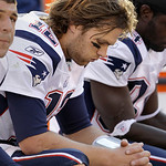 New England Patriots quarterback Tom Brady sits on the bench late in the fourth quarter of his teams 34-14 loss to the Cleveland Browns in their NFL football game on Sunday, Nov. 7, 2010, in ...