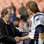 New England Patriots quarterback Tom Brady greets Lloyd Carr, his coach during his playing days at the University of Michigan, before plying the Cleveland Browns in an NFL football game on S ...