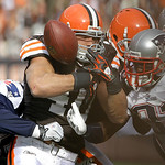 Cleveland Browns running back Peyton Hillis fumbles the ball as he is tackled by New England Patriots defensive end Jermaine Cunningham (96), left, and cornerback Devin McCourty (32), right, ...