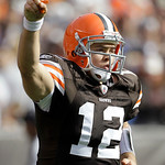 Cleveland Browns quarterback Colt McCoy comes off the field after teammate Peyton Hillis scored a rushing touchdown in the first quarter against the New England Patriots in their NFL footbal ...