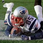 New England Patriots tight end Aaron Hernandez (85) slides out of bounds after catching a 1-yard touchdown pass in the fourth quarter of an NFL football game against the Cleveland Browns Sun ...