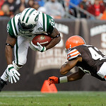 New York Jets running back LaDainian Tomlinson, left, is tackled by Cleveland Browns cornerback Raymond Ventrone after a nine-yard run in the first quarter of an NFL football game Sunday, No ...