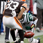 Cleveland Browns wide receiver Chansi Stuckey (83) has the ball knocked loose by New York Jets cornerback Drew Coleman (30) in overtime in an NFL football game Sunday, Nov. 14, 2010, in Clev ...
