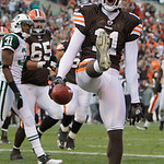 Cleveland Browns wide receiver Mohamed Massaquoi celebrates a three-yard touchdown-catch against the New York Jets late in the fourth quarter of an NFL football game Sunday, Nov. 14, 2010, i ...