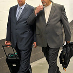 New York Jets head coach Rex Ryan, left, walks out of the stadium with his brother, Cleveland Browns defensive coordinator Rob Ryan, after an NFL football game Sunday, Nov. 14, 2010, in Clev ...