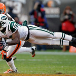New York Jets wide receiver Jerricho Cotchery (89) makes a diving catch for a first down in overtime against the Cleveland Browns in an NFL football game Sunday, Nov. 14, 2010, in Cleveland. ...