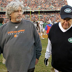 Cleveland Browns defensive coordinator Rob Ryan, left, and his brother, New York Jets head coach Rex Ryan, walk off the field after the Jets' 26-20 overtime win in an NFL football game Sunda ...
