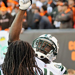 New York Jets wide receiver Santonio Holmes celebrates after his 37-yard touchdown-catch in overtime defeat the Cleveland Browns 26-20 in an NFL football game Sunday, Nov. 14, 2010, in Cleve ...