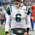 New York Jets quarterback Mark Sanchez celebrates after his 37-yard touchdown pass to Santonio Holmes gave the Jets a 26-20 win over the Cleveland Browns in overtime of an NFL football game  ...