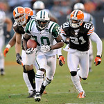 New York Jets wide receiver Santonio Holmes (10) breaks away from Cleveland Browns linebacker Eric Barton, left, and cornerback Eric Wright (21) on a 37-yard touchdown-catch in overtime of a ...