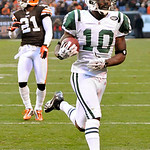 New York Jets wide receiver Santonio Holmes (10) breaks away on a 37-yard touchdown-reception in overtime to defeat the Cleveland Browns 26-20 in an NFL football game Sunday, Nov. 14, 2010,  ...
